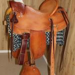 Lady Wade - Full bskt wv seat and front, corner basket wv, mule hide, straight-back, tapaderos, lady fenders, floral conchos