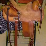 Rancher - latigo, barbed wr w channels, jockey and front basket weave, floral, rough-out seat and stirrup lthrs, dark straight-back, door handles on cantle