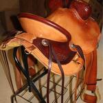 Rancher - latigo, dark straight-back, 2tone, floral, leathers out, 2 in stirrups, barbed wire w channels, corner bskt wv