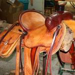 Rancher - sswirl w channels border, corner basket wv, latigo wrap, straight-back, 2-tone, floral conchos, saddlebags
