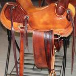 Rancher - 2tone, straight-back, stirrup lthrs out and tooled, full baskt wv, barbed wire w channels, latigo, floral