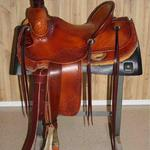 Rancher - barbed wire w channels, corner bskt wv, dark straight-back, leathers out, latigo, floral, bell stirrups