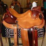 Wade - mule hide wrap, basket weave border, corner basket weave, 2-tone, stirrup leathers out and tooled, rope strap, cheyenne roll, floral conchos, fully tooled front and jockey
