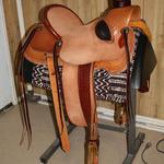 Wade -roughout seat and fenders,Santa Fe Diamond w channels,s-swirl border,basket weave jockey and front,bucking rolls,tooled stirrup leathers,latigo horn wrap,two-tone