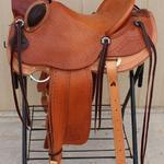 Wade -Santa Fe w scallop, fully toold seat,corner basket wv,mule hide,stirrup lthrs out_ tooled,floral conchos,bucking rolls,rawhide oxbows,wood post horn