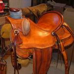Wade - bucking rolls, mule hide, straight-back, basket wv border, leathers out, floral conchos (1)