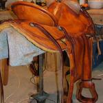 Wade - bucking rolls, mule hide, straight-back, basket wv border, leathers out, floral conchos (2)